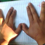 Please put your hands on a plain sheet of paper and widen your fingers. Check which hand is faster and which one has no problem widening the fingers.
